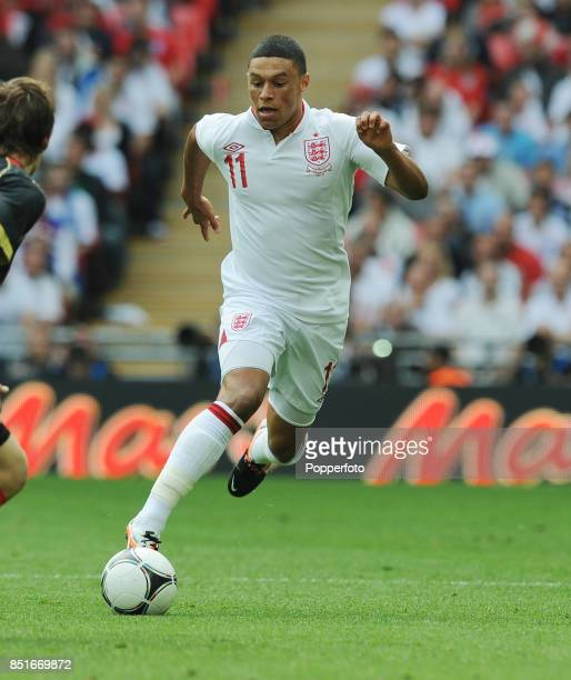 Alex OxladeChamberlain of England in action during the international friendly match between England and Belgium at Wembley Stadium on June 2 2012 in...