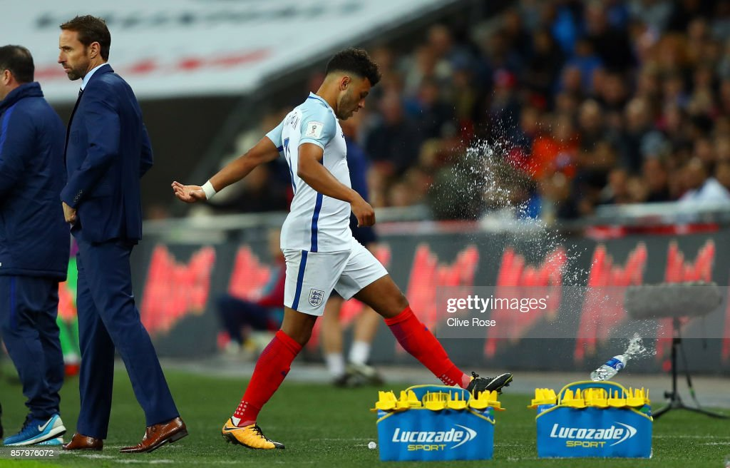 Alex Oxlade-Chamberlain of England reacts by kicking a bottle as he is substituted during the FIFA 2018 World Cup Group F Qualifier between England and Slovenia at Wembley Stadium on October 5, 2017 in London, England.