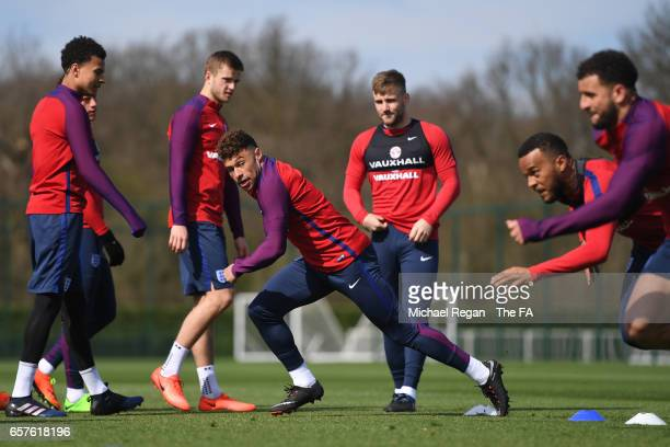 Alex OxladeChamberlain of England runs through drills with teammates during the England training session at the Tottenham Hotspur Training Centre on...
