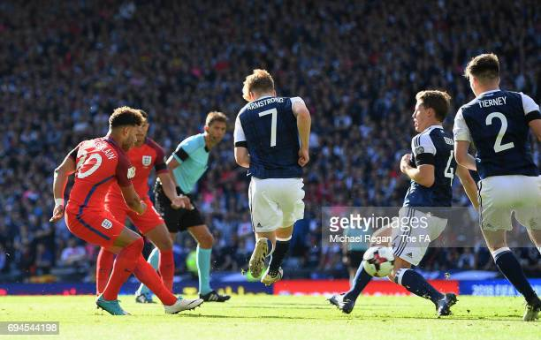 Alex OxladeChamberlain of England scores his sides first goal during the FIFA 2018 World Cup Qualifier between Scotland and England at Hampden Park...
