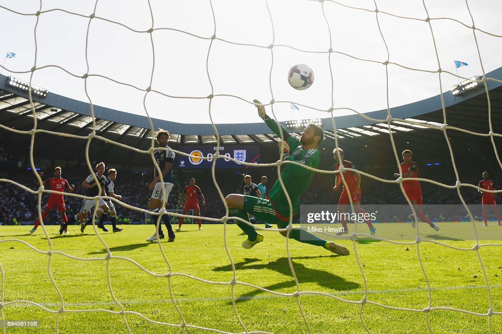 Alex Oxlade-Chamberlain of England scores his sides first goal past Craig Gordon of Scotland during the FIFA 2018 World Cup Qualifier between Scotland and England at Hampden Park National Stadium on June 10, 2017 in Glasgow, Scotland.