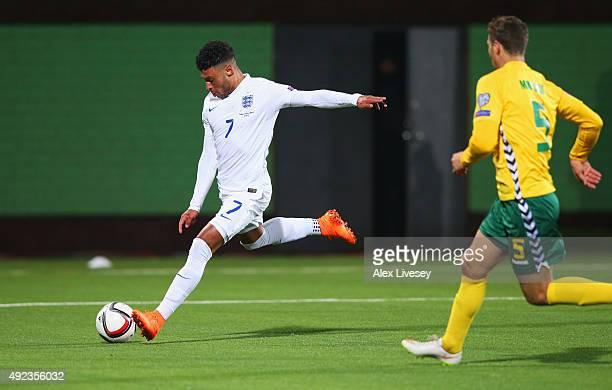 Alex OxladeChamberlain of England scores their third goal as Tomas Mikuckis of Lithuania looks on during the UEFA EURO 2016 qualifying Group E match...