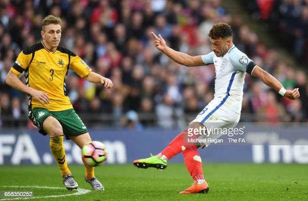 Alex OxladeChamberlain of England shoots past Vaidas Slavickas of Lithuania during the FIFA 2018 World Cup Qualifier between England and Lithuania at...