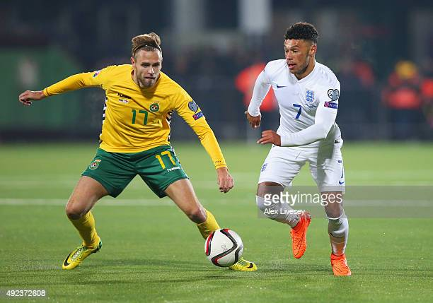 Alex OxladeChamberlain of England takes on Arturas Zulpa of Lithuania during the UEFA EURO 2016 qualifying Group E match between Lithuania and...