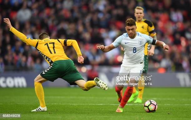 Alex OxladeChamberlain of England takes on Mantas Kuklys of Lithuania during the FIFA 2018 World Cup Qualifier between England and Lithuania at...