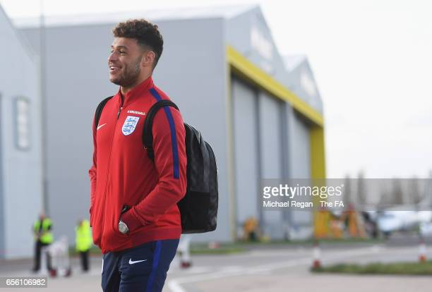Alex OxladeChamberlain of England walks to the plane as he leaves for the International Friendly match against Germany at Birmingham Airport on March...