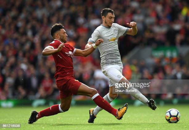 Alex OxladeChamberlain of Liverpool and Matteo Darmian of Manchester United battle for possession during the Premier League match between Liverpool...