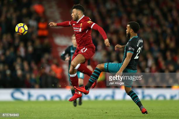 Alex OxladeChamberlain of Liverpool and Ryan Bertrand of Southampton compete for the ball during the Premier League match between Liverpool and...
