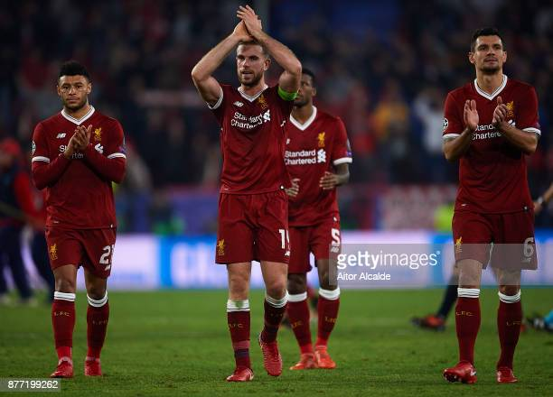 Alex OxladeChamberlain of Liverpool CF Jordan Henderson of Liverpool FC and Dejan Lovren of Liverpool FC waves to the fans after the end of the UEFA...