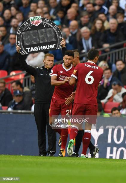 Alex OxladeChamberlain of Liverpool comes on for Dejan Lovren of Liverpool during the Premier League match between Tottenham Hotspur and Liverpool at...