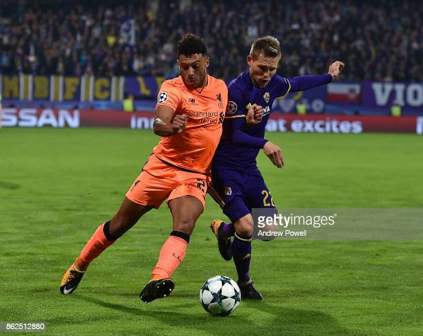 Alex OxladeChamberlain of Liverpool competes with Martin Milec of NK Mariborduring the UEFA Champions League group E match between NK Maribor and...