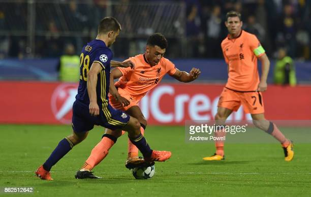 Alex OxladeChamberlain of Liverpool competes with Mitja Viler of NK Mariborduring the UEFA Champions League group E match between NK Maribor and...