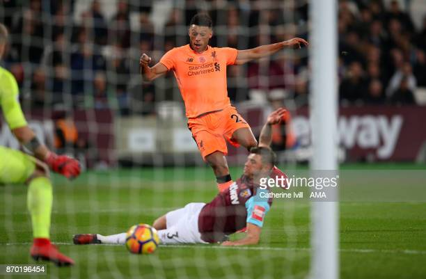 Alex OxladeChamberlain of Liverpool shoots during the Premier League match between West Ham United and Liverpool at London Stadium on November 4 2017...