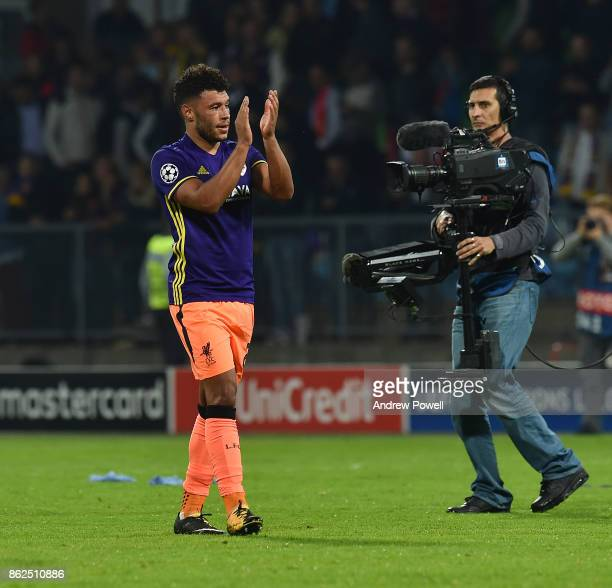 Alex OxladeChamberlain of Liverpool shows his appreciation to the fans at the end of the UEFA Champions League group E match between NK Maribor and...
