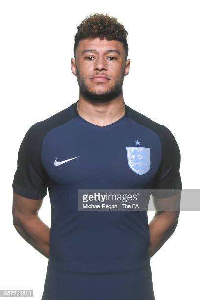 Alex OxladeChamberlain poses for an England team portrait at St Georges Park on March 20 2017 in BurtonuponTrent England