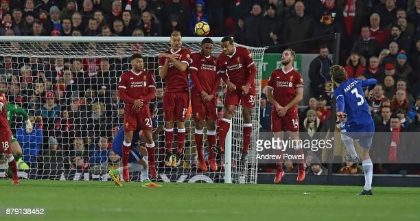 Alex OxladeChamberlain Ragnar Klavan Joe Gomez Joel Matip and Jordan Henderson of Liverpool defends a free kick from Marcos Alonso during the Premier...