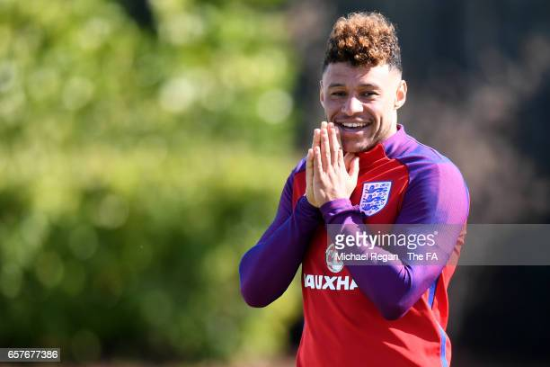 Alex OxladeChamberlain reacts during the England training session at the Tottenham Hotspur Training Centre on March 25 2017 in Enfield England