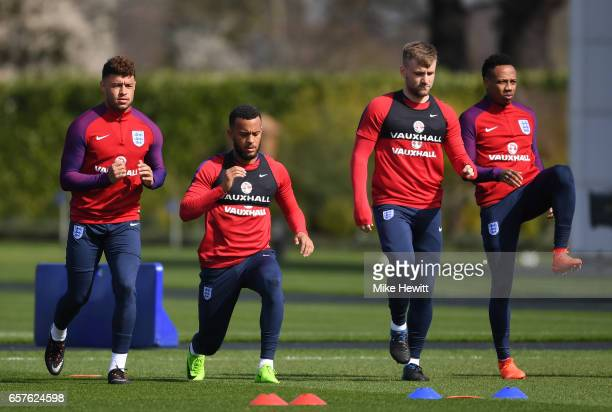 Alex OxladeChamberlain Ryan Bertrand Luke Shaw and Nathaniel Clyne of England run through drills during the England training session at the Tottenham...