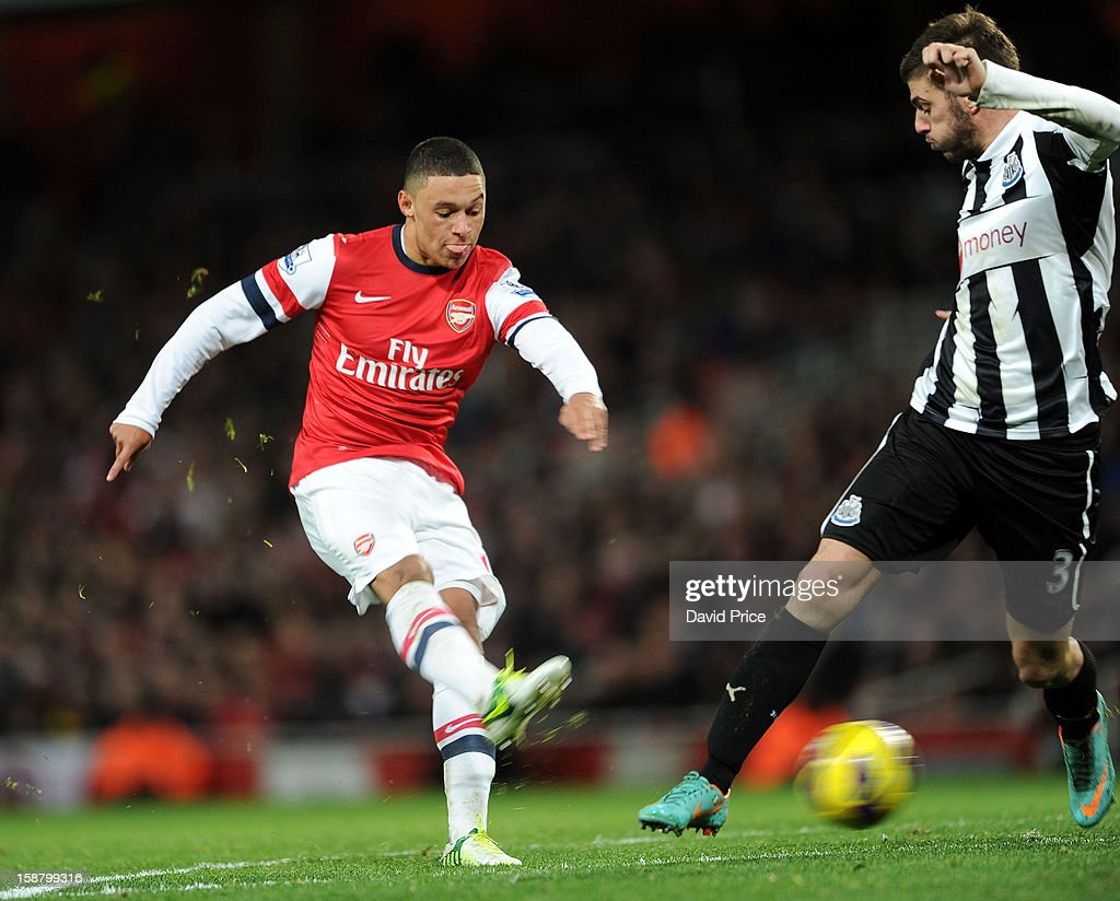 Alex Oxlade-Chamberlain scores Arsenal's 2nd goal past Davide Santon of Newcastle during the Barclays Premier League match between Arsenal and Newcastle United at Emirates Stadium on December 29, 2012 in London, England.