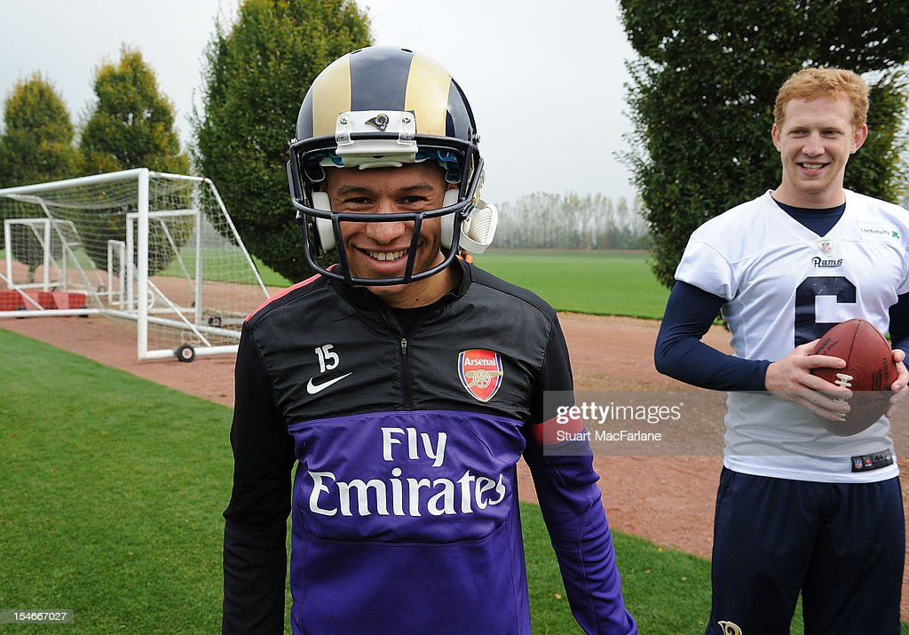 Alex Oxlade-Chamberlain wears a St Louis Rams helmet at London Colney on October 24, 2012 in St Albans, England.