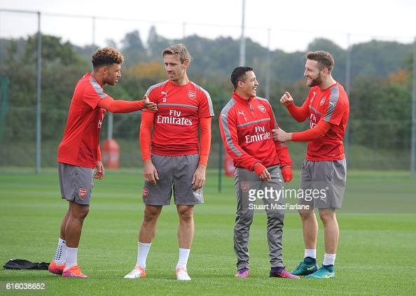 Alex OxladeChamnerlain Nacho Monreal Alexis Sanchez and Shkodran Mustafi of Arsenal during a training session at London Colney on October 21 2016 in...