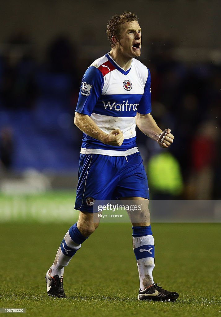 Alex Pearce of Reading celebrates after their victory over West Ham United in the Barclays Premier League match between Reading and West Ham United...
