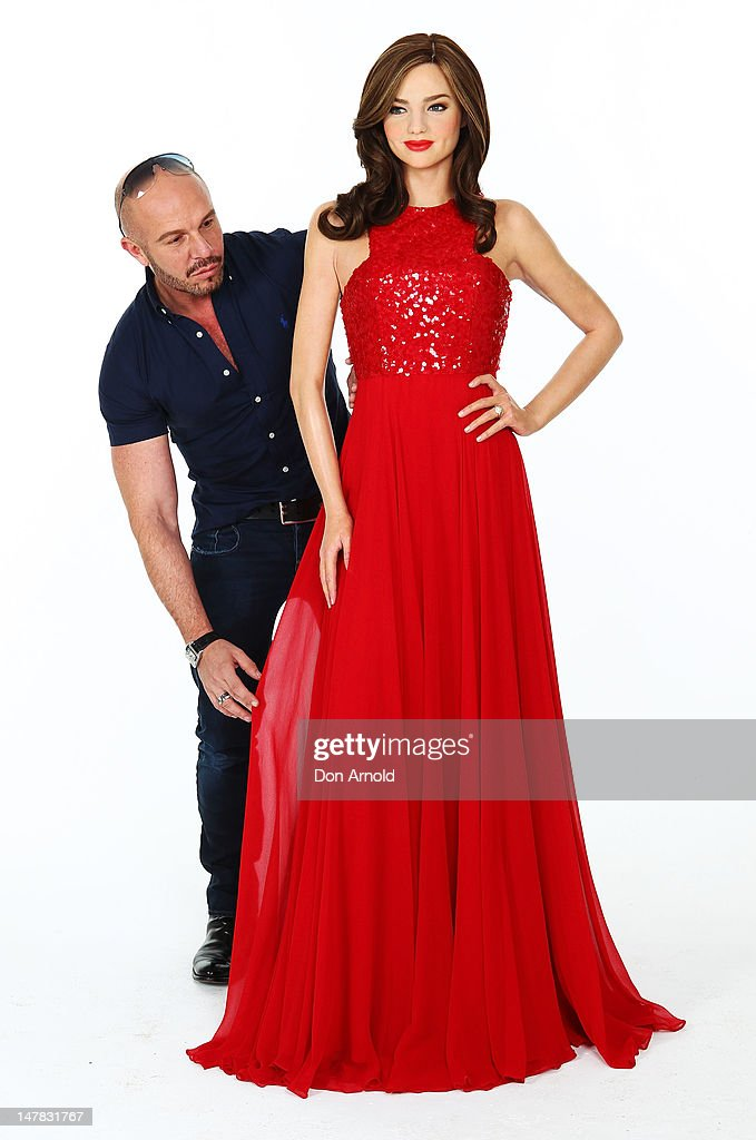 Alex Perry tends to a dress worn by a <a gi-track='captionPersonalityLinkClicked' href=/galleries/search?phrase=Miranda+Kerr&family=editorial&specificpeople=5714330 ng-click='$event.stopPropagation()'>Miranda Kerr</a> wax figure as it is unveiled at The Photo Studio on July 5, 2012 in Sydney, Australia.
