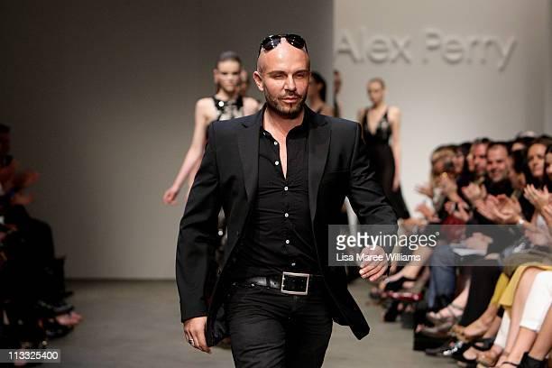 Alex Perry walks the catwalk following his show during Rosemount Australian Fashion Week Spring/Summer 2011/12 at Overseas Passenger Terminal on May...