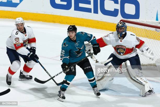 Alex Petrovic and Roberto Luongo of the Florida Panthers defend against Kevin Labanc of the San Jose Sharks at SAP Center at San Jose on February 15...