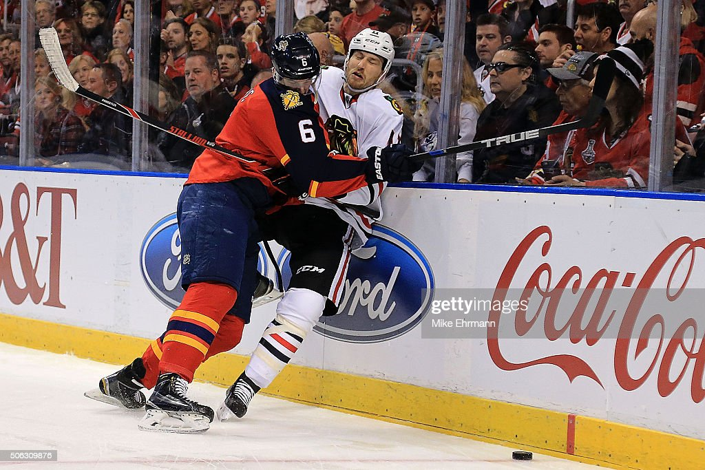 <a gi-track='captionPersonalityLinkClicked' href=/galleries/search?phrase=Alex+Petrovic&family=editorial&specificpeople=8639704 ng-click='$event.stopPropagation()'>Alex Petrovic</a> #6 of the Florida Panthers checks <a gi-track='captionPersonalityLinkClicked' href=/galleries/search?phrase=Andrew+Desjardins&family=editorial&specificpeople=2748431 ng-click='$event.stopPropagation()'>Andrew Desjardins</a> #11 of the Chicago Blackhawks during a game at BB&T Center on January 22, 2016 in Sunrise, Florida.