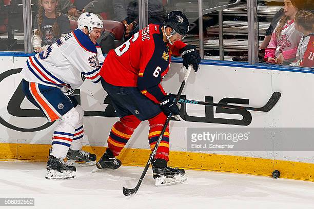 Alex Petrovic of the Florida Panthers tangles with Mark Letestu of the Edmonton Oilers at the BBT Center on January 18 2016 in Sunrise Florida