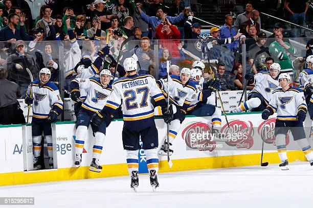 Alex Pietrangelo and the St Louis Blues celebrate the game winning overtime goal against the Dallas Stars at the American Airlines Center on March 12...