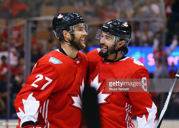 Alex Pietrangelo of Team Canada celebrates his third period goal agaist Team Czech Republic and is joined by Drew Doughty during the World Cup of...