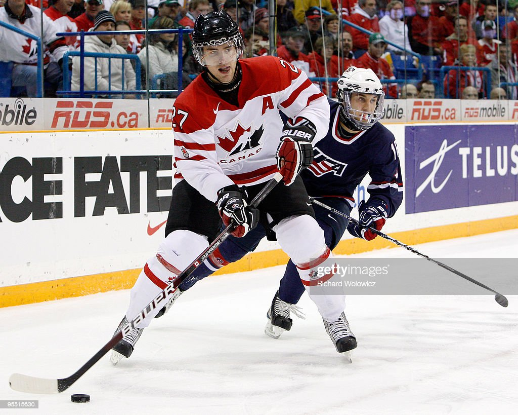Alex Pietrangelo #27 of Team Canada skates with the puck while being chased by Jason Zucker #16 of Team USA during the 2010 IIHF World Junior Championship Tournament game on December 31, 2009 at the Credit Union Centre in Saskatoon, Saskatchewan, Canada.