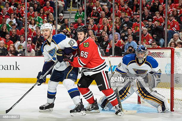 Alex Pietrangelo of the St Louis Blues and Andrew Shaw of the Chicago Blackhawks wait in front of goalie Ryan Miller of the Blues in Game Six of the...