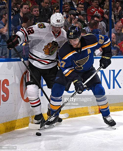 Alex Pietrangelo of the St Louis Blues and Joakim Nordstrom of the Chicago Blackhawks battle for the puck on April 9 2015 at the Scottrade Center in...