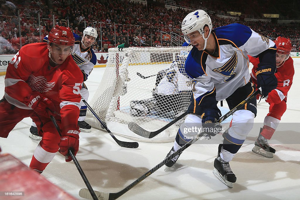 Alex Pietrangelo #27 of the St Louis Blues battles along the boards with Valtteri Filppula #51 of the Detroit Red Wings during a NHL game at Joe Louis Arena on February 13, 2013 in Detroit, Michigan. The Blues won in overtime 4-3