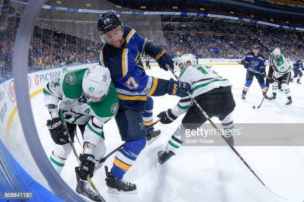 Alex Pietrangelo of the St Louis Blues battles for the puck against Alexander Radulov of the Dallas Stars and Mattias Janmark of the Dallas Stars on...