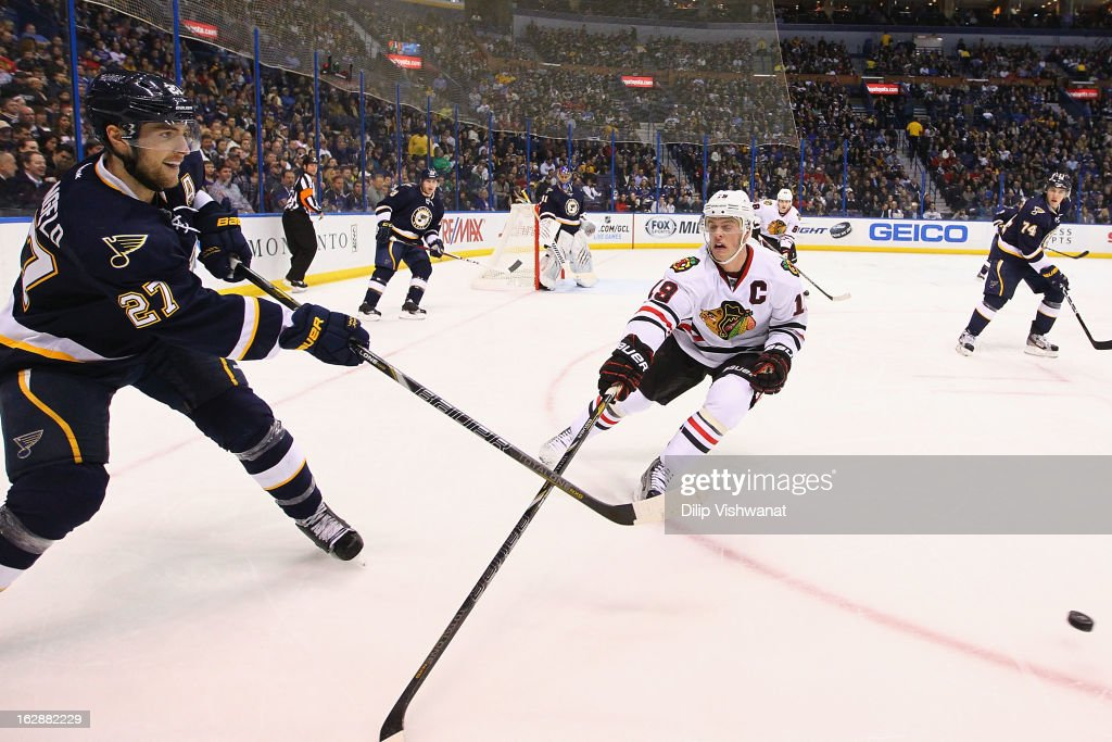 <a gi-track='captionPersonalityLinkClicked' href=/galleries/search?phrase=Alex+Pietrangelo&family=editorial&specificpeople=4072229 ng-click='$event.stopPropagation()'>Alex Pietrangelo</a> #27 of the St. Louis Blues clears the puck against <a gi-track='captionPersonalityLinkClicked' href=/galleries/search?phrase=Jonathan+Toews&family=editorial&specificpeople=537799 ng-click='$event.stopPropagation()'>Jonathan Toews</a> #19 of the Chicago Blackhawks at the Scottrade Center on February 28, 2013 in St. Louis, Missouri.