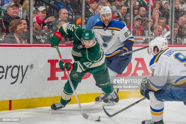 Alex Pietrangelo of the St Louis Blues defends Nino Niederreiter of the Minnesota Wild in Game One of the Western Conference First Round during the...