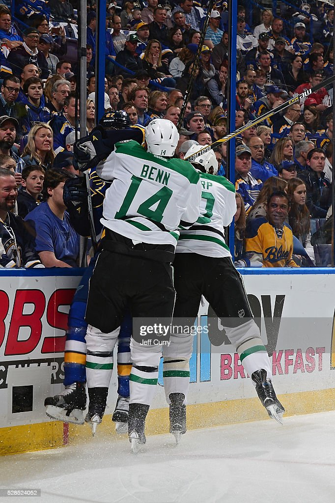 <a gi-track='captionPersonalityLinkClicked' href=/galleries/search?phrase=Alex+Pietrangelo&family=editorial&specificpeople=4072229 ng-click='$event.stopPropagation()'>Alex Pietrangelo</a> #27 of the St. Louis Blues is checked by <a gi-track='captionPersonalityLinkClicked' href=/galleries/search?phrase=Jamie+Benn&family=editorial&specificpeople=4595070 ng-click='$event.stopPropagation()'>Jamie Benn</a> #14 and <a gi-track='captionPersonalityLinkClicked' href=/galleries/search?phrase=Patrick+Sharp&family=editorial&specificpeople=206279 ng-click='$event.stopPropagation()'>Patrick Sharp</a> #10 of the Dallas Stars in Game Four of the Western Conference Second Round during the 2016 NHL Stanley Cup Playoffs at the Scottrade Center on May 5, 2016 in St. Louis, Missouri.
