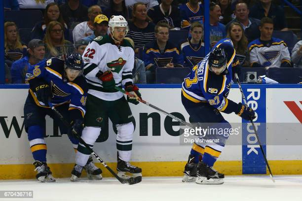 Alex Pietrangelo of the St Louis Blues passes the puck to Ivan Barbashev against Nino Niederreiter of the Minnesota Wild in Game Four of the Western...