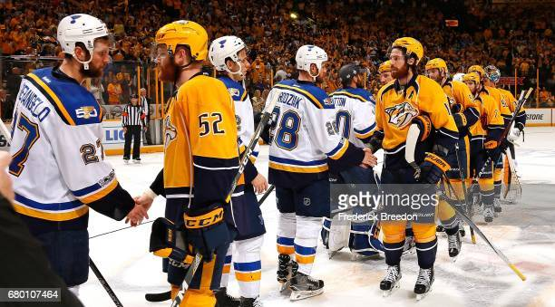 Alex Pietrangelo of the St Louis Blues shakes hands with Matt Irwin of the Nashville Predators and Kyle Brodziak shakes hands with James Neal of the...