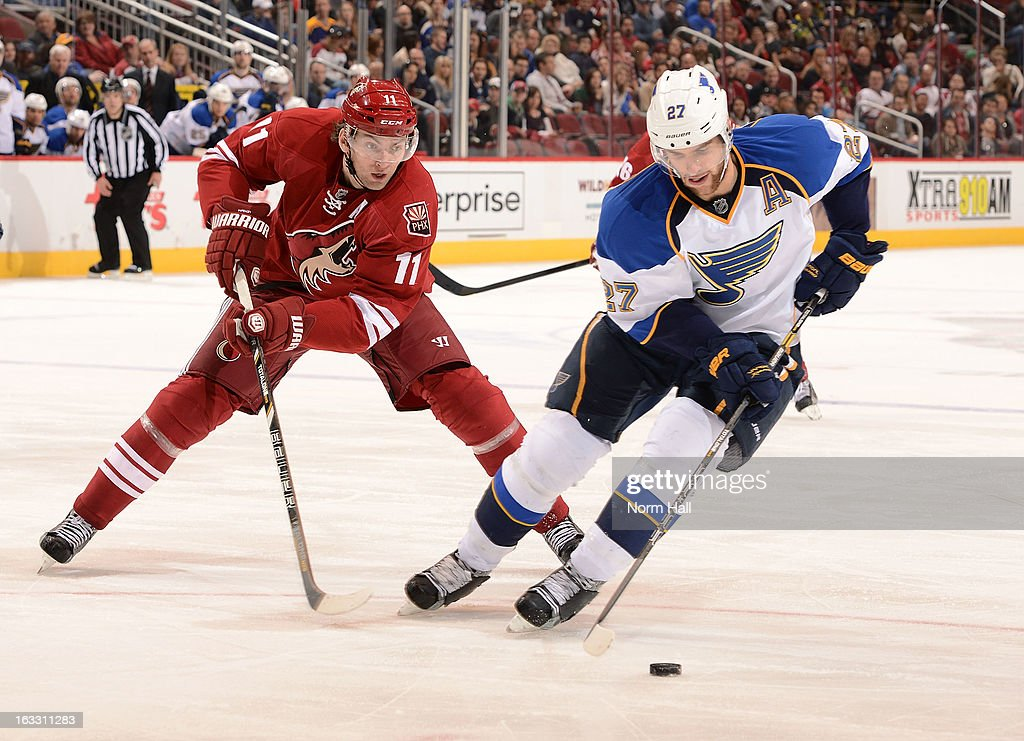<a gi-track='captionPersonalityLinkClicked' href=/galleries/search?phrase=Alex+Pietrangelo&family=editorial&specificpeople=4072229 ng-click='$event.stopPropagation()'>Alex Pietrangelo</a> #27 of the St Louis Blues skates the puck away from <a gi-track='captionPersonalityLinkClicked' href=/galleries/search?phrase=Martin+Hanzal&family=editorial&specificpeople=2109469 ng-click='$event.stopPropagation()'>Martin Hanzal</a> #11 of the Phoenix Coyotes during the second period at Jobing.com Arena on March 7, 2013 in Glendale, Arizona.
