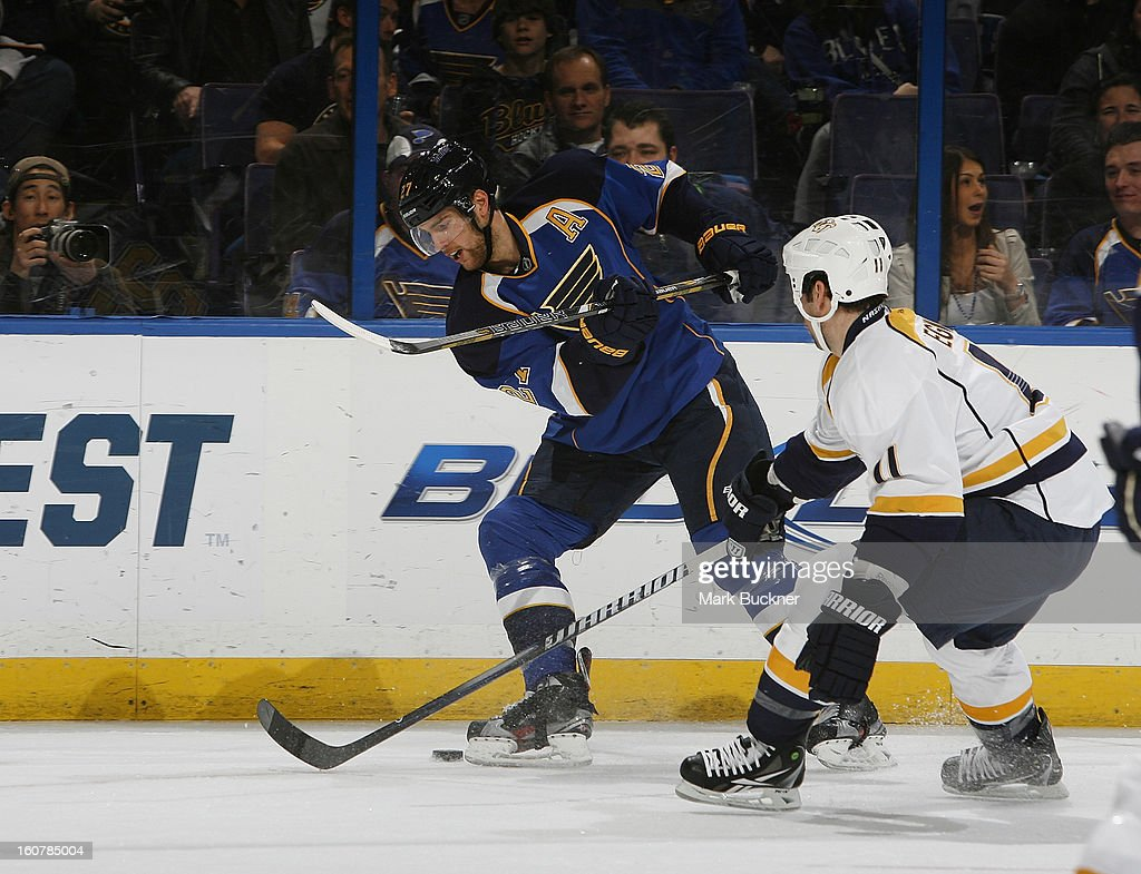 Alex Pietrangelo #27 of the St. Louis Blues tries to clear the puck past David Legwand #11 of the Nashville Predators in an NHL game on February 5, 2013 at Scottrade Center in St. Louis, Missouri.