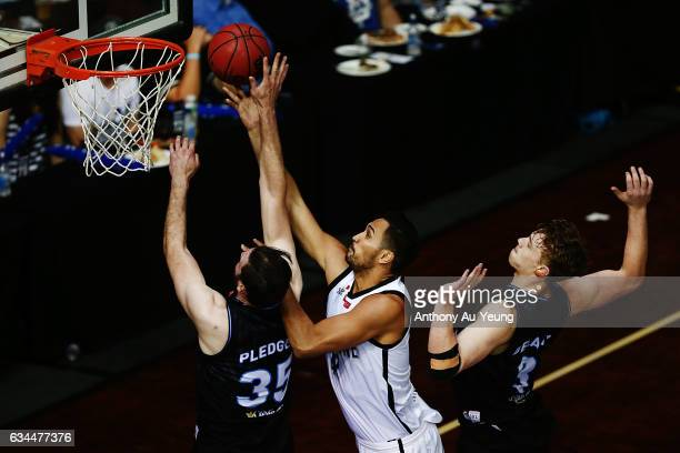 Alex Pledger of the Breakers blocks the shot from Tai Wesley of United during the round 19 NBL match between the New Zealand Breakers and Melbourne...