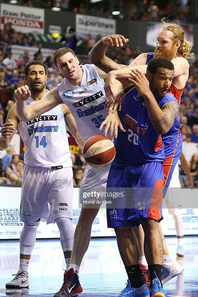 Alex Pledger of the Breakers competes for the ball with Luke Schenscher and BJ Anthony of the 36ers during the round four NBL match between the...