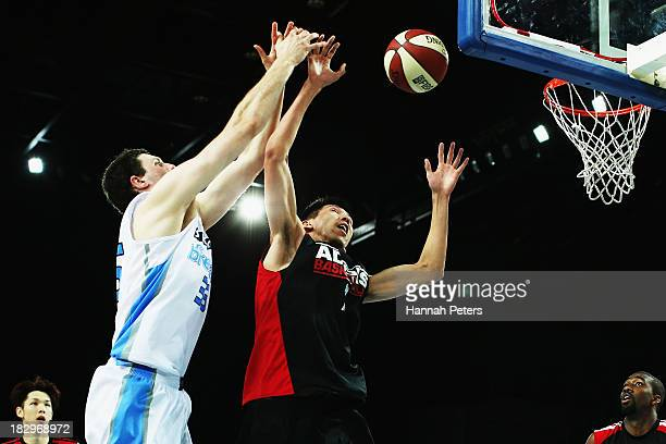 Alex Pledger of the Breakers competes with Kai Zhang of the Leopards during the NBL preseason match between the New Zealand Breakers and the Dongguan...