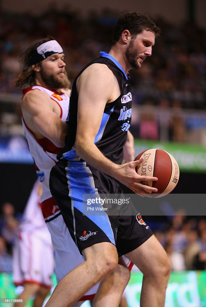 Alex Pledger of the Breakers is put under pressure from Larry Davidson of the Hawks during the round 18 NBL match between the New Zealand Breakers and the Wollongong Hawks at the North Shore Events Centre on February 15, 2013 in Auckland, New Zealand.