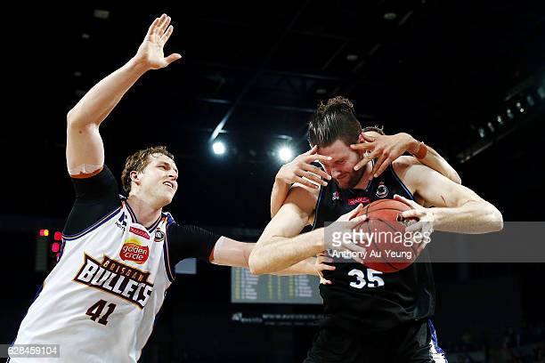 Alex Pledger of the Breakers protects the ball against Daniel Kickert and Cameron Bairstow of the Bullets during the round 10 NBL match between the...